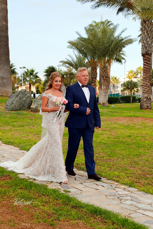 the bride coming with her father for the wedding ceremony |  wedding reception venue in Larnaca, Beach wedding reception venue in Larnaca, Civil Ceremonies  larnaca Cyprus, Civil Ceremonies aradippou larnaca Cyprus