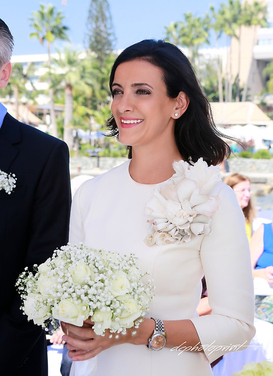 Gorgeous young bride with dark hair in elegant wedding dress  holding bright bouquet in hands |  limassol wedding photography,  weddings photographer limassol