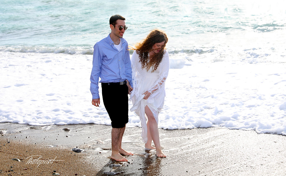 Beautiful and gentle winter wedding photo session outdoors of the elegant couple at Paphos beach
