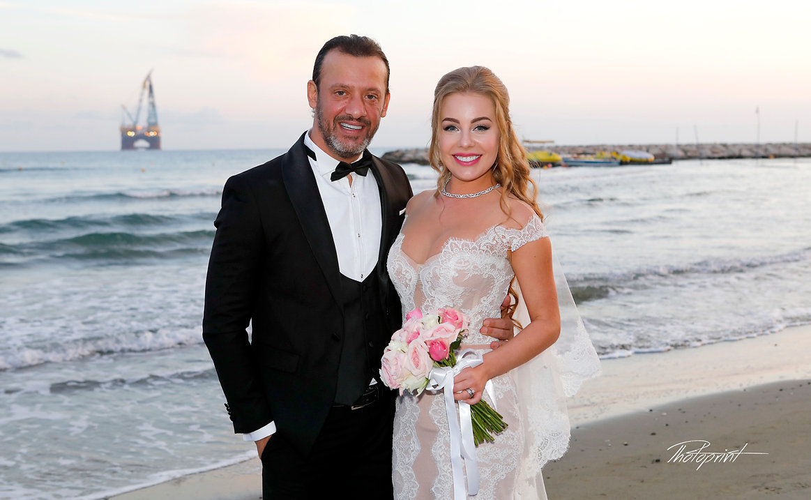 Just married couple on walking on the beach at sunset. lebanese wedding photography and prices, lebanese wedding in cyprus, cyprus wedding photographer for lebanese,  lebanon wedding photography prices, larnaca wedding photographer, professionalwedding photographers cyprus, town Hall pics photographer, Larnaca photographers, photographers in Larnaca.