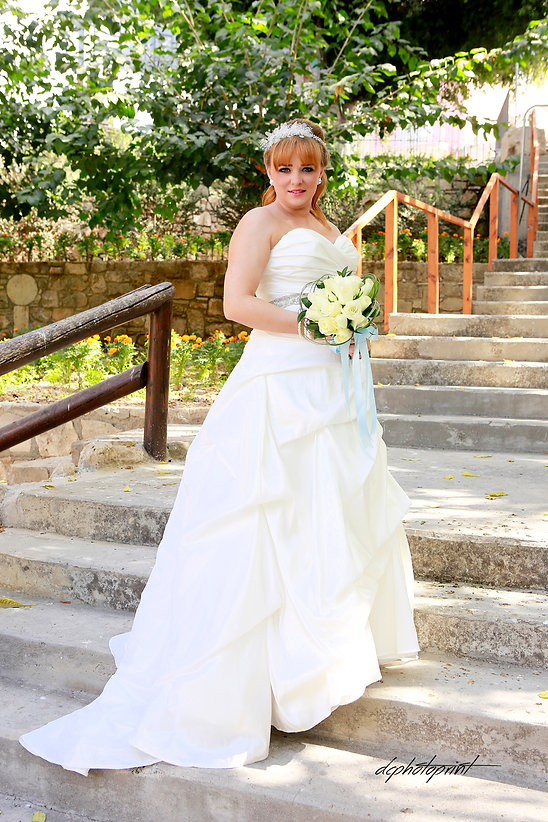 Gorgeous bride in wedding dress with bouquet of flowers posing before the wedding near Ottomas baths in Paphos  | cyprus wedding photography cost, yprus cheap wedding photographer price