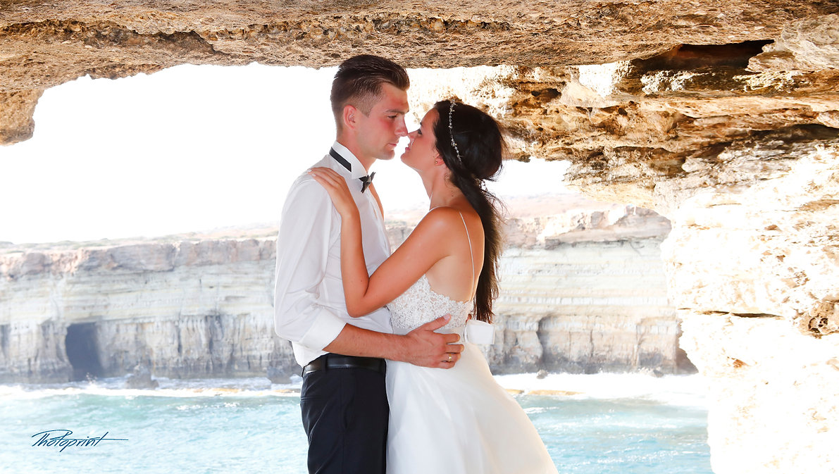 Side View Beautiful Wedding Couple Holding Hands Looking Each Other at Gavo Greco near ayia napa | cyprus wedding best photography in ayia napa town hall, cyprus wedding best photographer ayia napa municipality