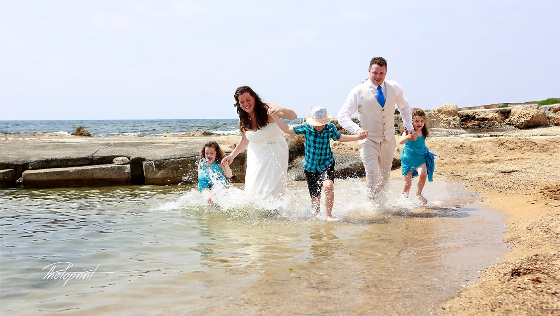 Happy just married young wedding couple celebrating | cyprus wedding photographer paphos, ayia napa wedding photographers, cyprus wedding photographers limassol