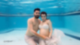 Bride and groom at the pool underwater | wedding in ayia napa underwater photography, cyprus cheap wedding photographer reviews