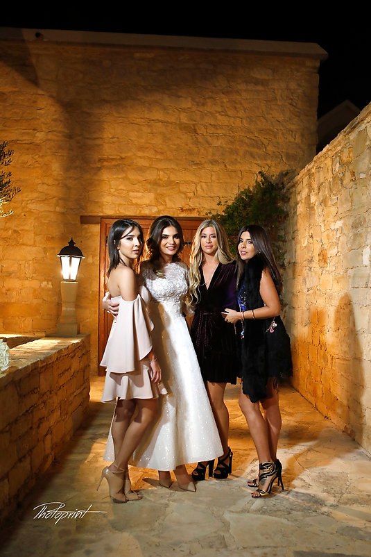 Bride and bridesmaid have a small party before the wedding ceremony | yermasoyia wedding photography venues, cyprus wedding  yermasoyia photographer