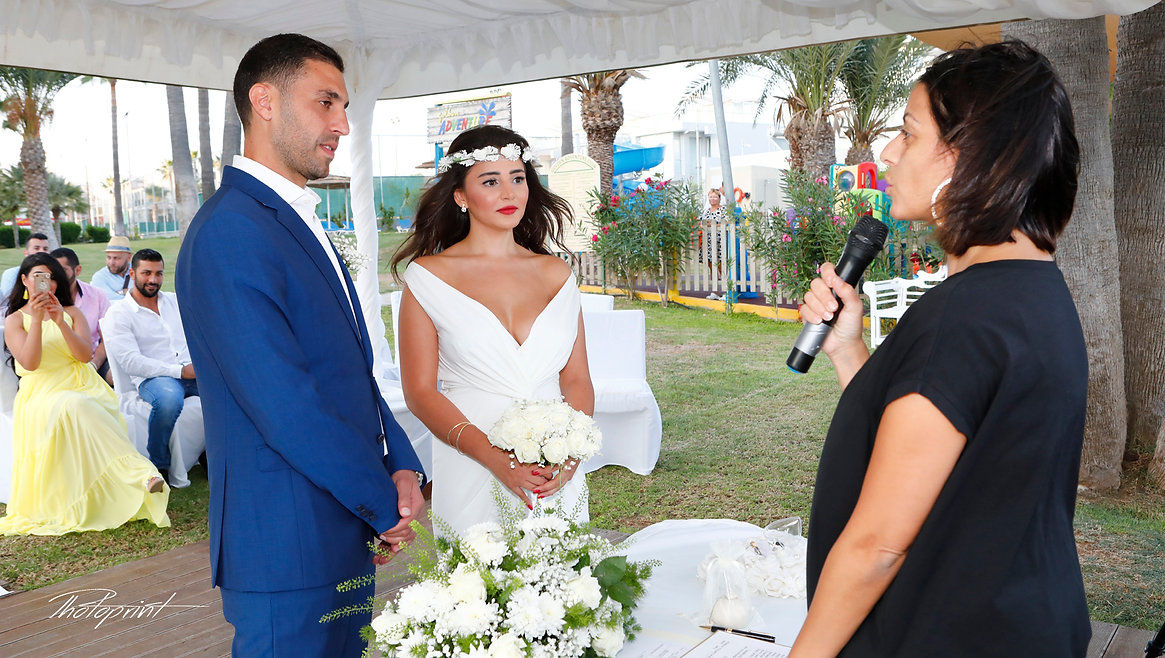 Beautiful and gentle wedding ceremony photo session in Golden Bay Beach Hotel, Larnaca outdoors elegant couple  | Photographers in Larnaca, Wedding Venues in Cyprus for lebanese, ebanese weddings - photoprint cyprus