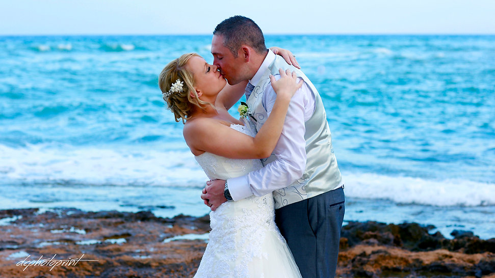 Bride and Groom, Kissing at Pernera beach Hotel on a Beautiful Mediterranean Beach Protaras | wedding photographer protaras, professional wedding photographer protaras cyprus