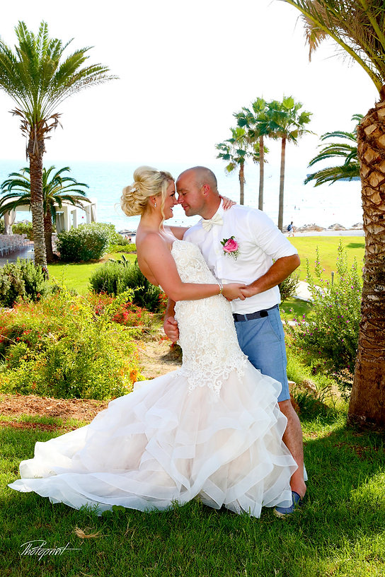Picture of romantic young couple having a walking by the beach near Nissi Beach Resort in ayia napa | Nissi Beach resort best wedding photos cyprus