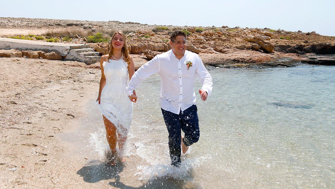 Couple running on a sandy beach |  cyprus photographer ayia napa,cyprus wedding photographer ayia napa, cyprus photographers ayia napa