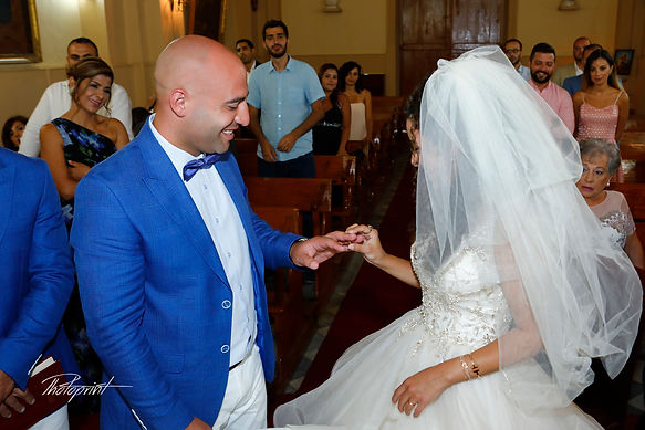 The bride wears the ring groom | photographers wedding ceremonies in lebanon , photographers wedding ceremonies for lebanese in lebanon and larnaca, photographer weddings in cyprus  and Lebanon