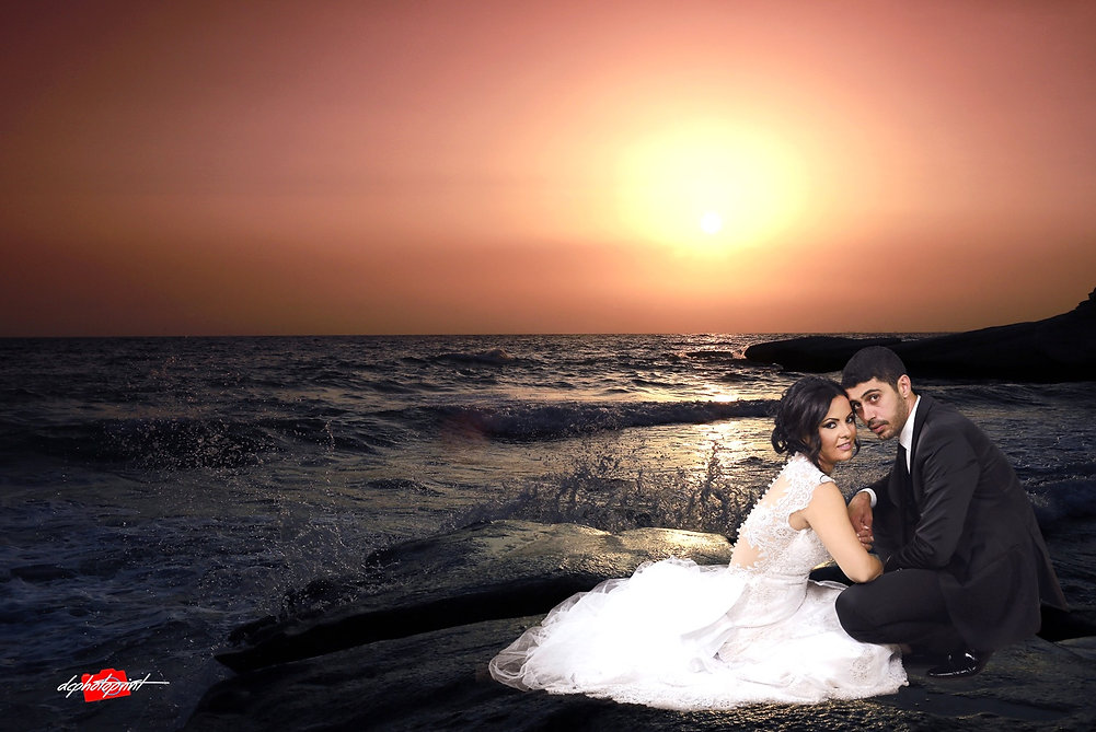 Wedding couple holding hands on sunset. The Mediterranean Sea on background | wedding photographers paphos prices,cyprus cheap wedding photographer paphos