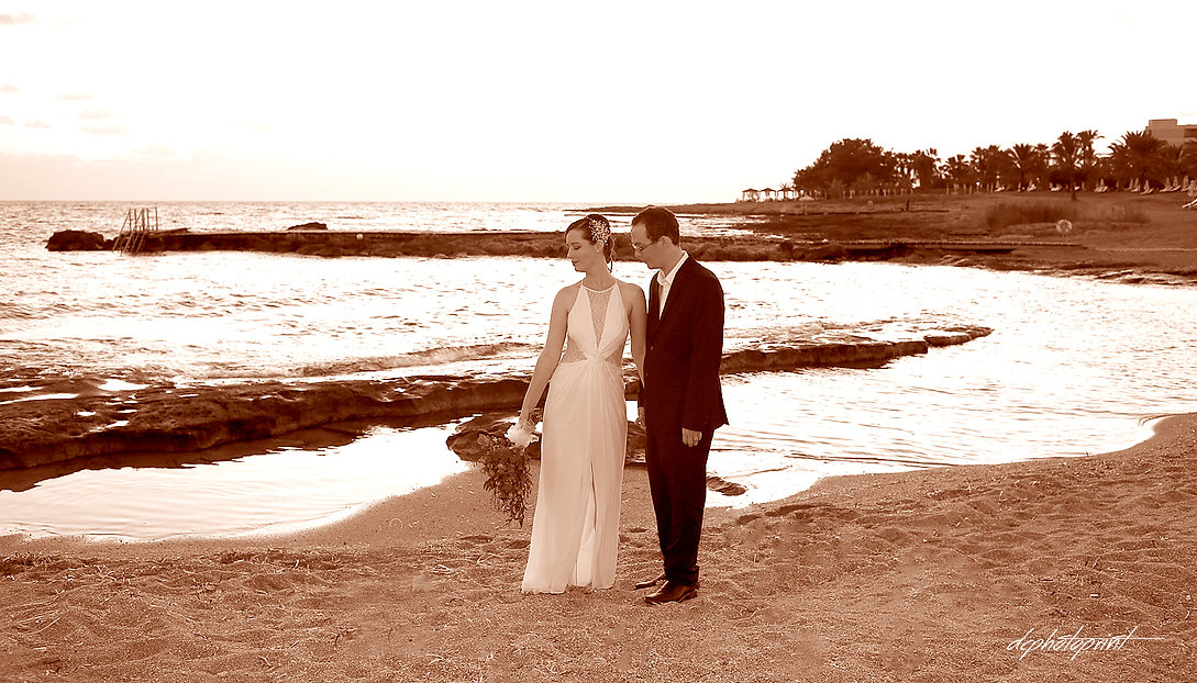 Elegant smiling bride and groom walking on the bech at Athena Beach Hotel paphos | marriage at city hall paphos, Paphos best wedding photographer photography