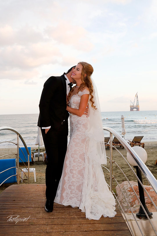 Happy couple after the wedding ceremony on Wedding Ceremony in Golden Bay hotel, larnaca | Larnaca wedding photographer, larnaca civil wedding photographer,Lebanese wedding ceremony in cyprus