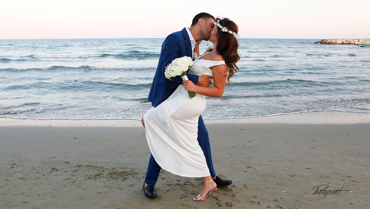 Picture of Elegant beautiful Just married couple romantic on the sea, kissing | wedding photo ideas larnaca cyprus, married in larnaca municipality cyprus