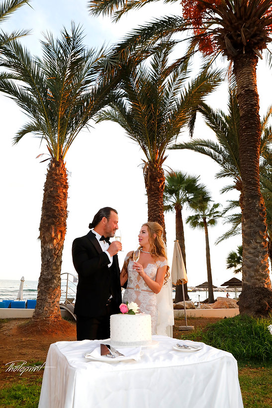 Bride and groom holding champagne glasses | Wedding photographers in Larnaca,Photographers in Larnaca Cyprus, Larnaca Wedding Photographers, Wedding videographer Larnaca