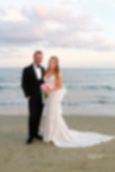 Happy just married young wedding couple celebrating and have fun at beautiful beach sunset | Larnaca Wedding Photographers,cyprus wedding larnaca photography prices, cyprus wedding photography prices