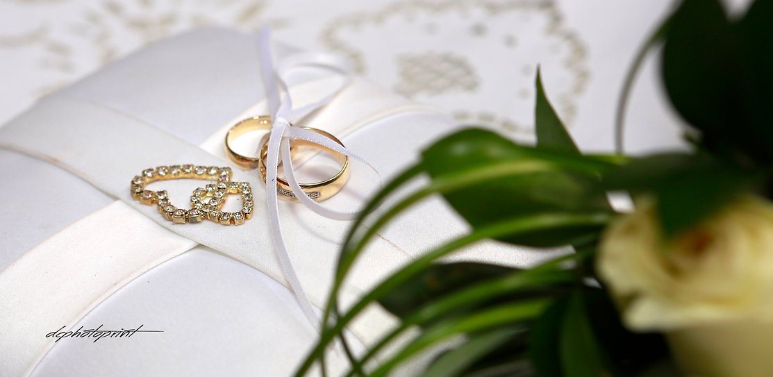 Two golden wedding rings and flowers |  bridal photographer  cyprus, budget wedding photographer cyprus