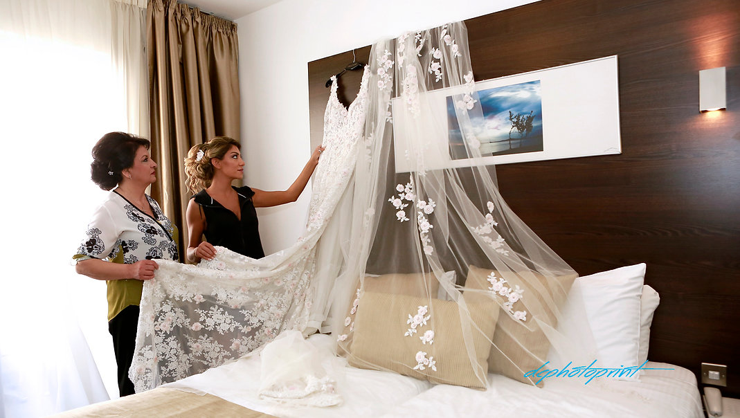 Mother and bride prepare the wedding dress befofe the wedding | wedding photo ideas protaras cyprus, wedding photography ideas protaras cyprus