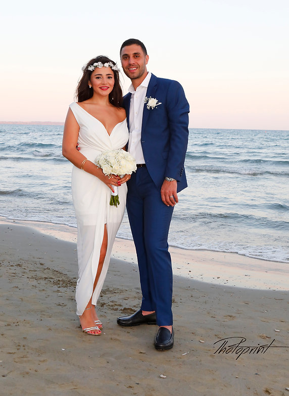 Beautiful and gentle wedding photo session outdoors of the elegant couple, bride in a white dress with veil holding a bouquet and groom in the classic costume, romantic portrait | city hall larnaca wedding photography cyprus, larnaca best weddings abroad