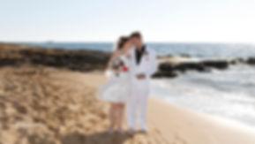 Beautiful wedding couple walking on beach at sunset holding hands   bridal photographer paphos, bridal photography paphos, budget wedding photographer paphos