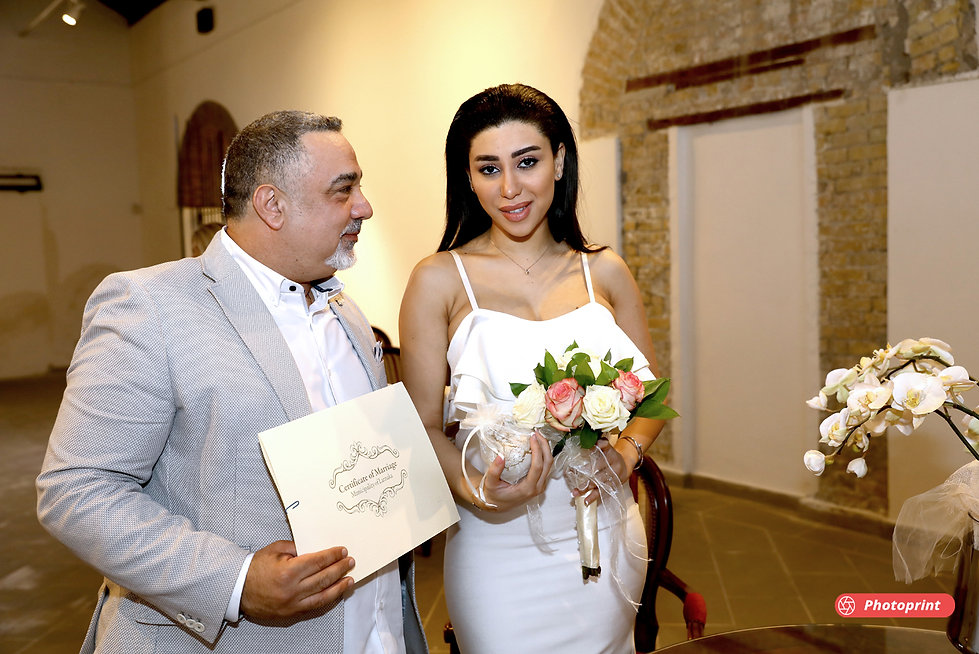 Happy just married young wedding couple celebrating | limassol wedding photographers prices