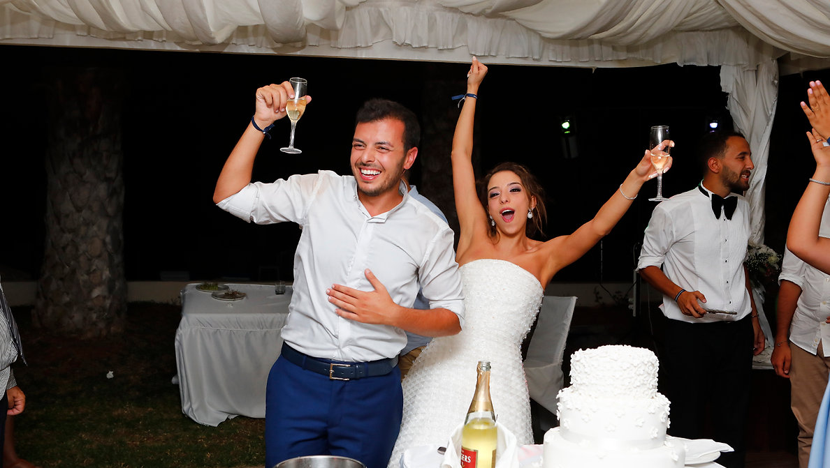 Wedding couple outdoor holding champagne glasses and have fun | best cyprus wedding photographers,cyprus wedding photography prices, cyprus wedding photographer reviews