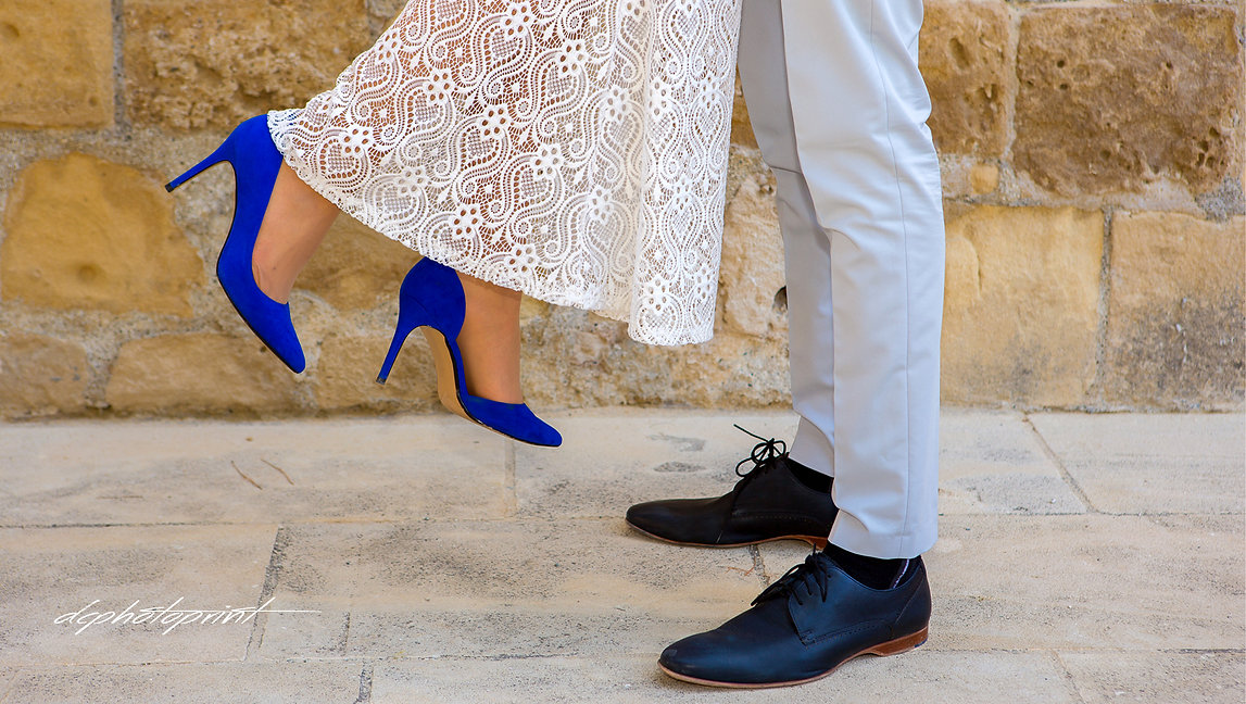 Wedding shoes in a standing bride and groom | civil marriage in cyprus for israeli couples in larnaca, wedding photographer  in cyprus for israeli, wedding photographers  in cyprus for israeli, wedding in cyprus for israeli
