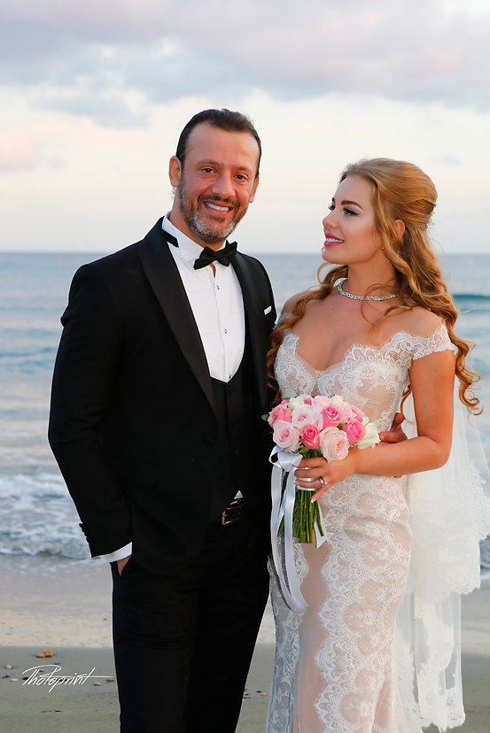 Happy just married young wedding couple celebrating and have fun at beautiful beach sunset of GOLDEN BAY BEACH  Hotel, Larnaca Cyprus |  planning a wedding in larnaca, weddings in Larnaca town hall, beach weddings in Larnaca cyprus,hotel weddings in Larnaca cyprus
