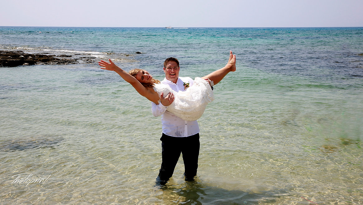 Elegant beautiful Just married couple in love in the beach on Mediterranean sea | wedding photographer cost ayia napa, wedding photographer cyprus ayia napa, wedding photographer in ayia napa cyprus