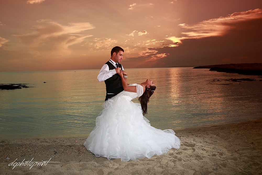 Bride and Groom,Kissing at Colorful sunset over the Beautiful Mediterranean sea at ayia napa, cyprus  | married in ammos tou Kampouri cyprus - Stunning photographer
