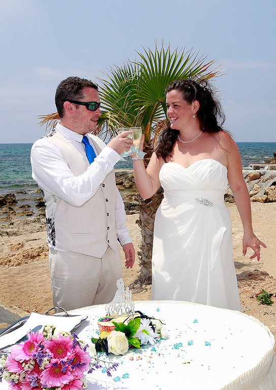 Wedding Young couple enjoying romantic moments outside on a wedding summer day, the magnificent blue Mediterranean Sea on background | cyprus wedding photographers paphos, married in paphos municipality cyprus,wedding paphos photography cyprus