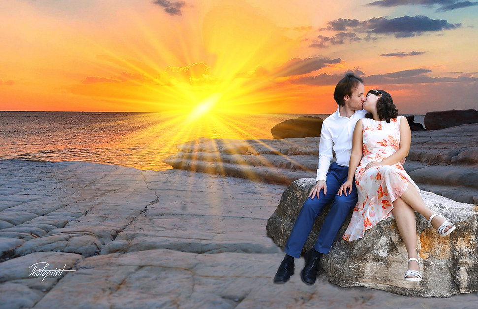 Handsome young groom kissing his wife by the beach on sunset at Paphos |