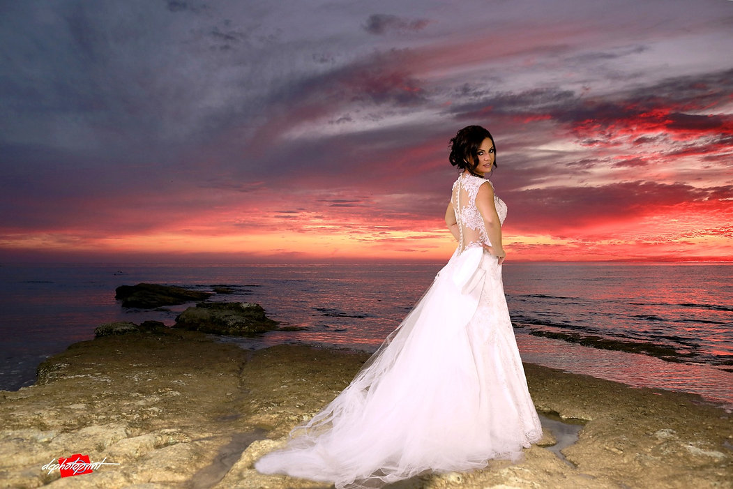 Portrait of gorgeous beautiful bride in white dress with amazing hair style and make up, colorful sunset over the sea | Paphos town hall weddings venues, cyprus cheap venues wedding photographers Paphos