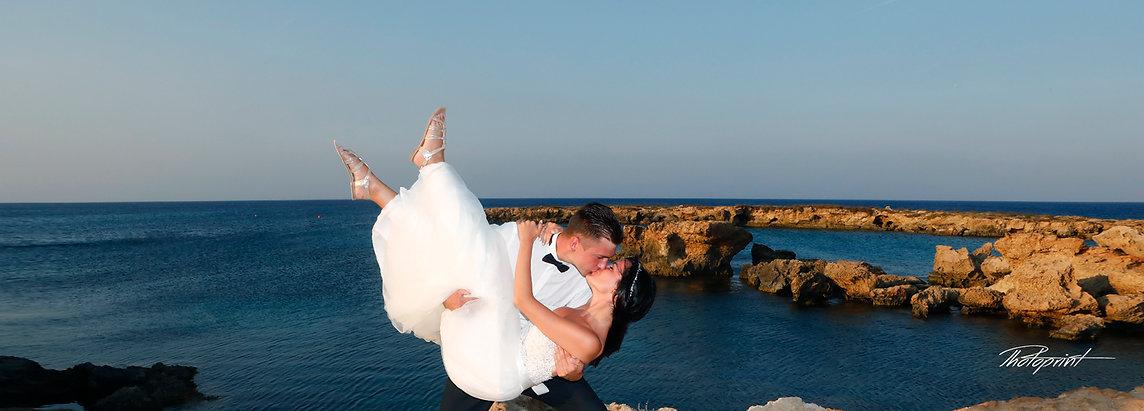 Fine art photo of an attractive wedding couple by Protaras beach, cyprus | photographer for wedding in protaras, cyprus sunset images wedding photography protaras