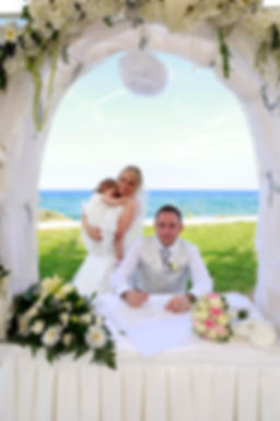 Groom signing marriage license on wedding contract  at Pernera Beach Hotel in Protaras Cyprus | protaras beach hotel wedding photography, cyprus dream wedding photography protaras