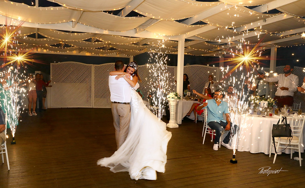Beautiful wedding dance with fireworks show at the background  after the wedding | cyprus wedding photography cost