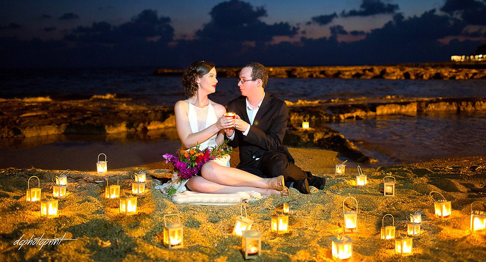 Picture of romantic young couple on the sea shore after the wedding
