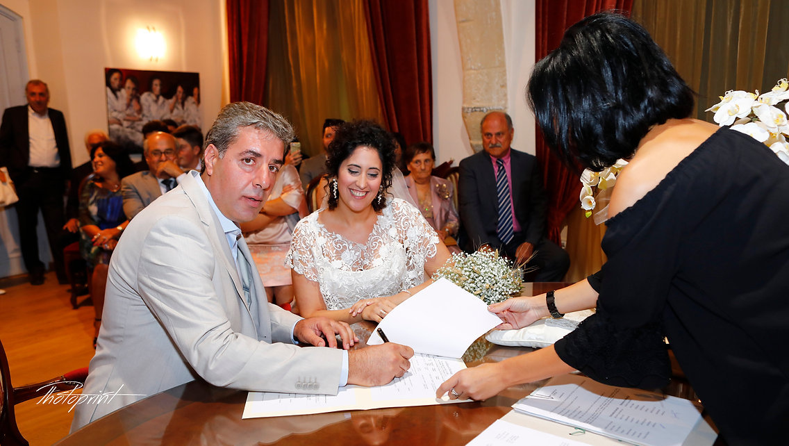 Closeup of young groom signing wedding contract at  Larnaca municipality | Larnaca city hall wedding photography cyprus