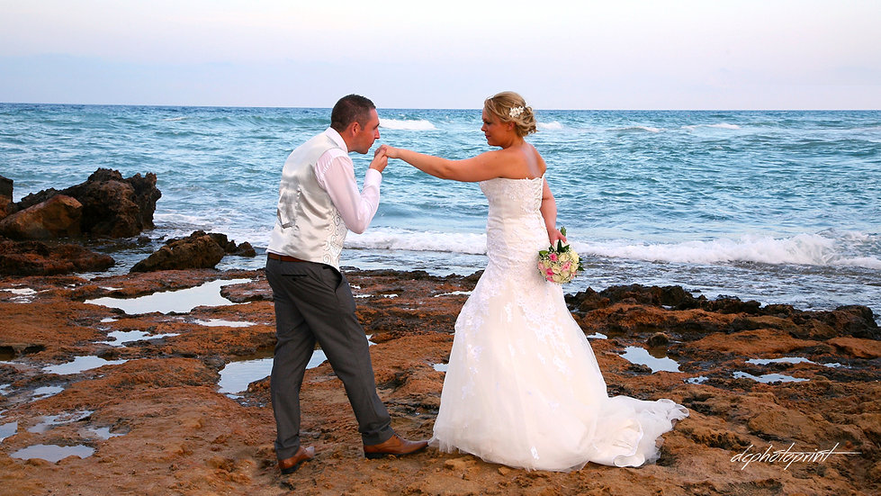 Picture of Elegant beautiful Just married romantic Bride and Groom, Kissing at the Pernera beach Hotel on a Beautiful Mediterranean Beach Protaras, cyprus | cyprus dream wedding photography protaras, protaras  best wedding photos cyprus