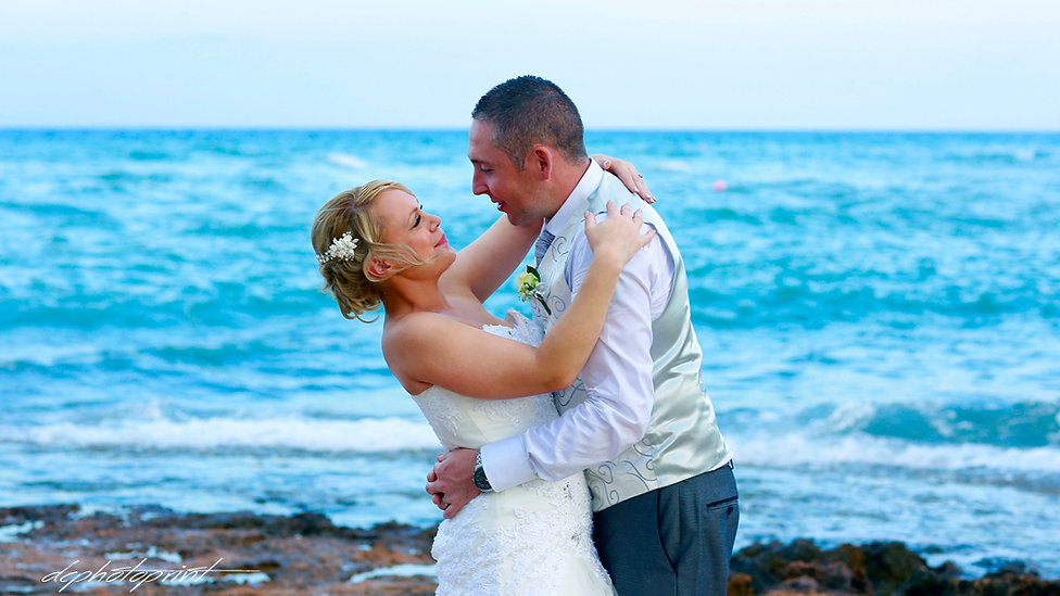 Picture of Elegant beautiful Just married couple romantic on the Pernera beach Hotel, cyprus | protaras beach hotel wedding photography, civil protaras wedding photography