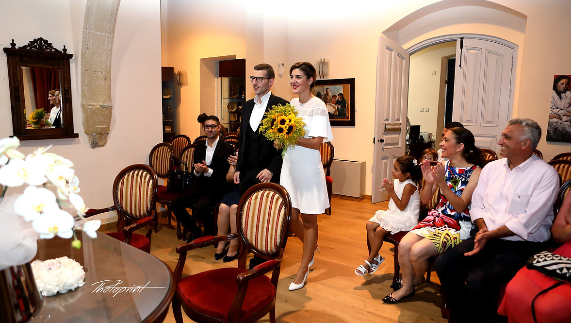 Couple during wedding ceremony in Larnaca Municipality Town Hall | cyprus wedding photographer larnaca,civil wedding photography in larnaca