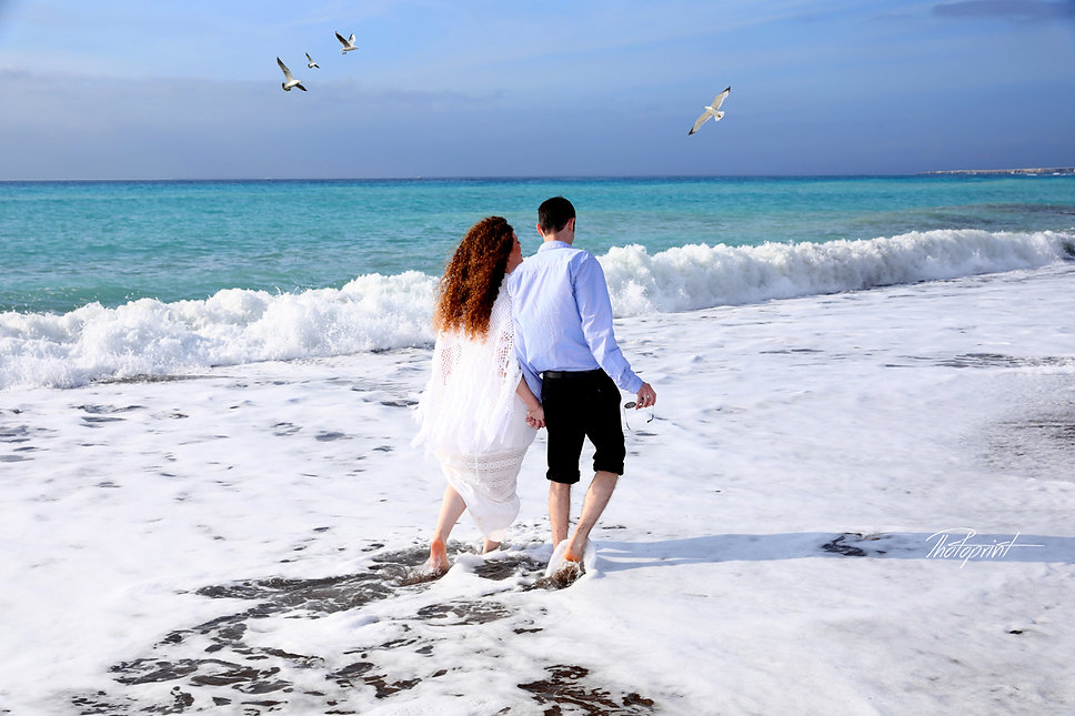 Picture of romantic young couple having a walking on the sea shore, Geroskipou - Paphos