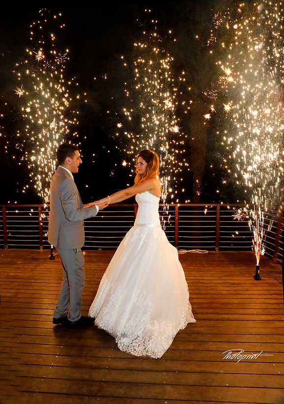 Newly married couple dancing on their wedding party background heavy beautiful fireworks with lots of stars wedding photo ideas protaras cyprus, photographer in protaras, cyprus wedding photographers protaras