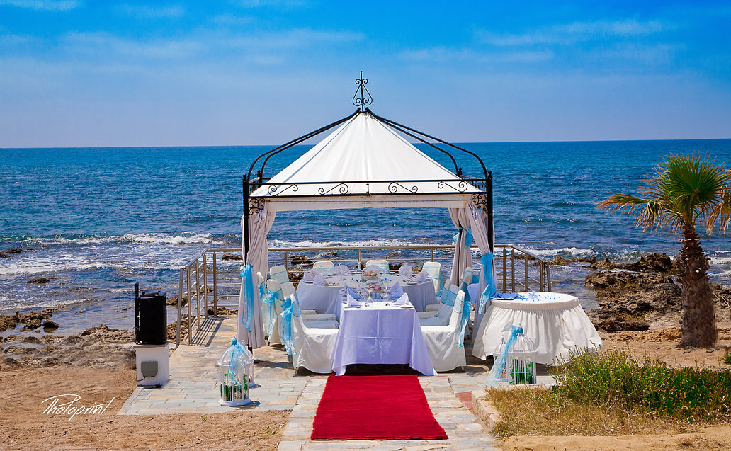Luke and Sarah's Romantic Kiosk for their wedding celebration outdoors decorated with flowers on Mediterranean sand beach, in Kefalos tourist village Paphos  | wedding paphos photographer photography, cyprus wedding photography paphos, Paphos best wedding photographer photography