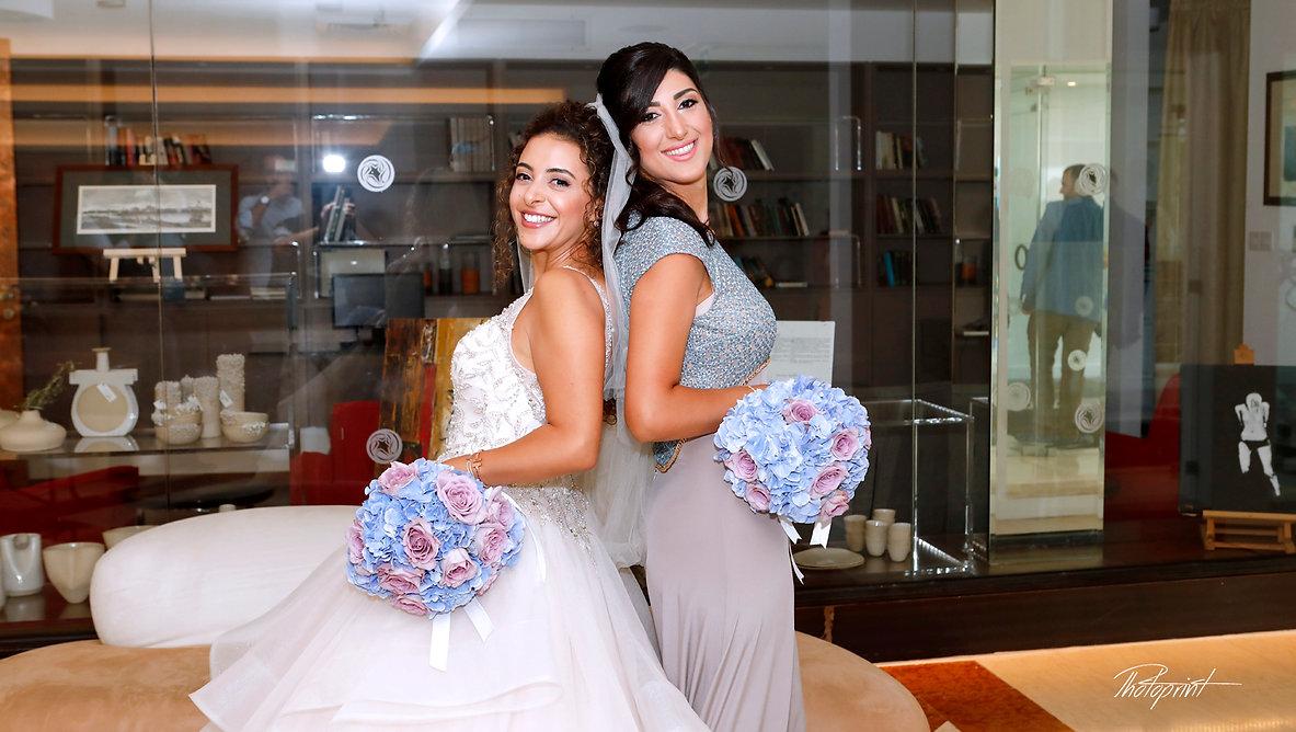 Bride and bridesmaid with wedding bouquets | larnaca weddings cyprus,  larnaca civil weddings photographers, larnaca civil wedding photographer