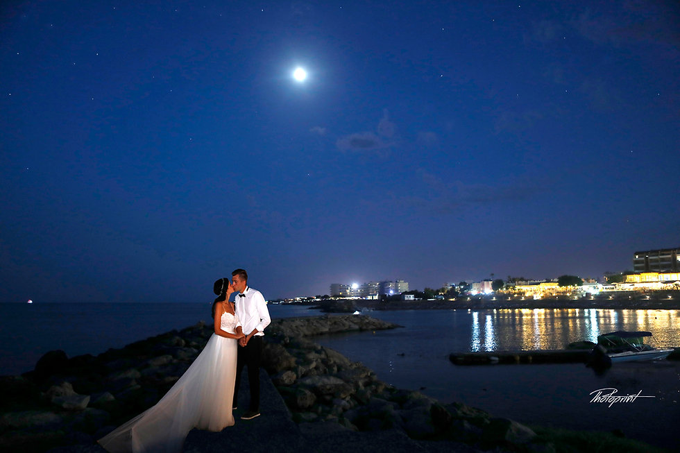 Midnight Blue Coastal Moon rise With starry sky, Bride and Groom kissing on Protaras sea beach without Waves | wedding portfolio