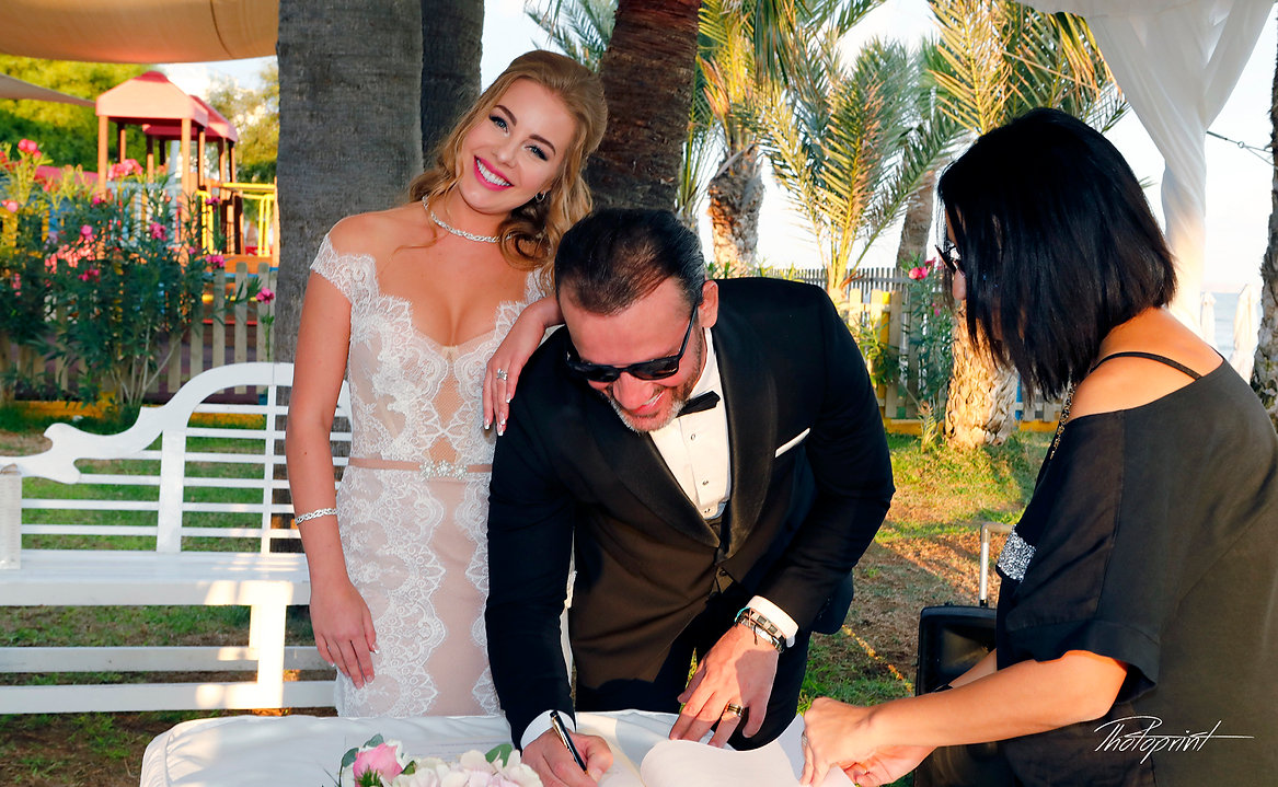 Happy young Bride and Groom signing registration form  |  cyprus dream weddings in larnaca cyprus, cyprus wedding photograprers in larnaca, cyprus best wedding photographer in larnaca, Civil Ceremonies  larnaca Cyprus, lebanese Civil Ceremonies  larnaca Cyprus, Civil Ceremonies aradippou larnaca Cyprus, Civil ceremony at Larnaka town hall located near the beach, larnaca municipality civil wedding,  larnaca municipality civil wedding.