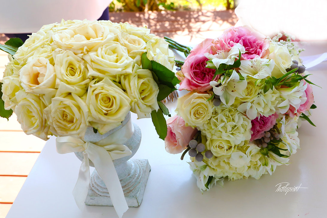 Romance two bouquet with various flowers and white roses | cyprus wedding photographers prices