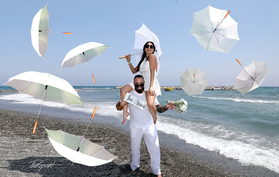 Happy Wedding celebration decorated with flying umbrellas on Mediterranean sand beach