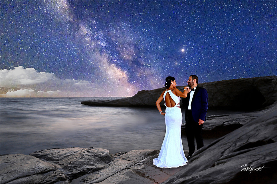 Beautiful and gentle wedding photo session outdoors of the elegant couple in night under the galaxy at  background